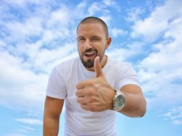 Blue Sky Young Man Success Luxury Watch Thumbs Up