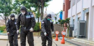 spraying disinfectant on street